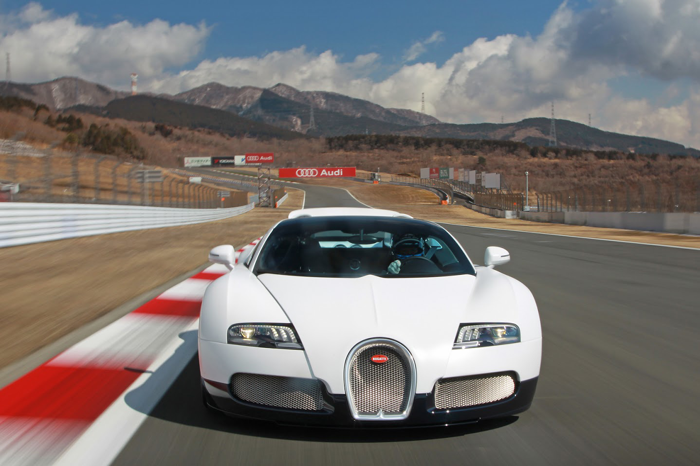 Video: Seeing the Bugatti Veyron being hammered around a race-track from a drivers POV is awesome!