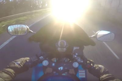 Video: Biker Gets Completely Blinded By The Sun, Crashes Right Into A Car!