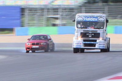 Video: A Bmw 1m Challenges A Man Truck To A Race At Magny Cours. Who Wins?