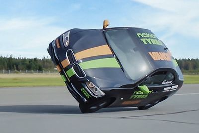 Video: Crazy Driver Sets World Speed Record Driving On Two Wheels!!